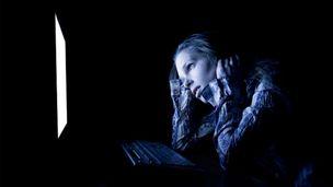 Sad woman on computer